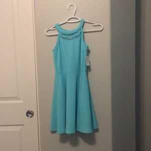 Brand new turquoise kids dress.